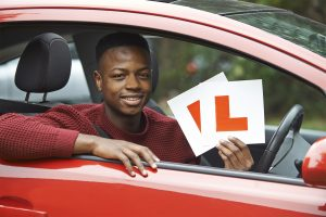 learner driver with l plates in car window